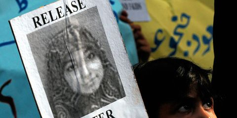 child with poster of aaifia