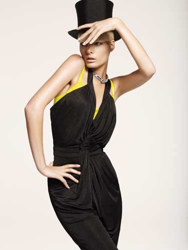 model in black jumpsuit and top hat