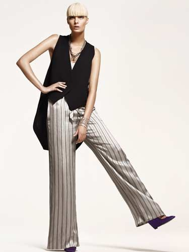 model in black tuxedo vest and pajama pants