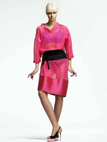 model with hot pink dress and black cumberbund