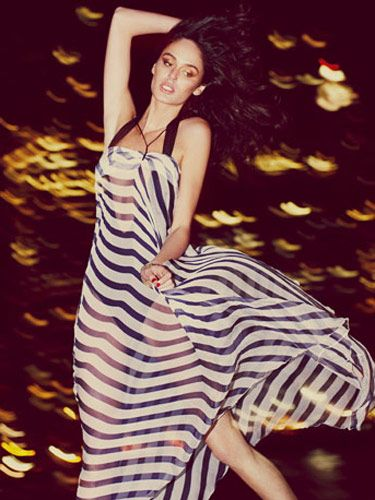 model in windblown striped transparent dress over swimsuit