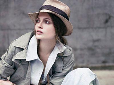 girl in hat dress and leggings