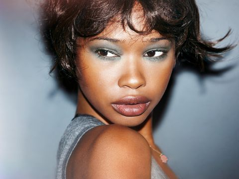 dark skinned model in green shiseido eyeshadow
