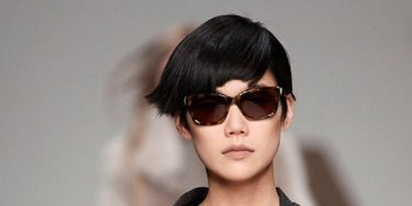 runway model in menswear blazer and sunglasses