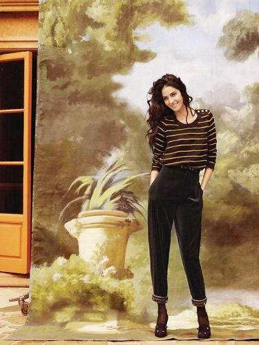 black and yellow striped shirt and black velvet pants