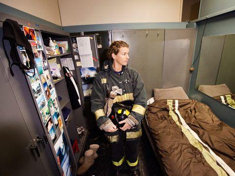 female firefighter in firehouse bedroom