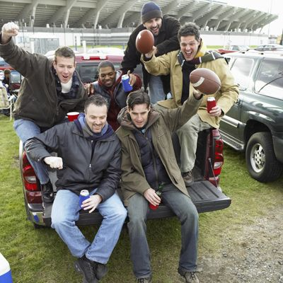 men tailgating at a football game