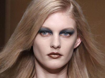 model with dark blue eye shadow