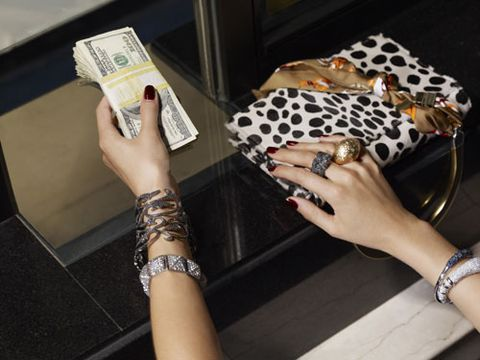 hand with jewelry and money