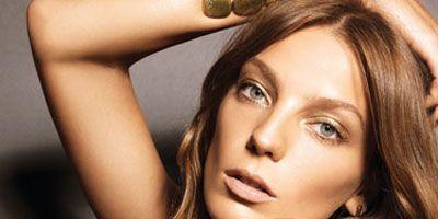 model wearing gold makeup