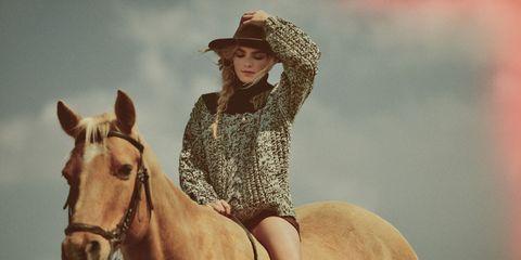 model on horse