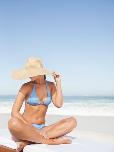 woman floppy hat on beach