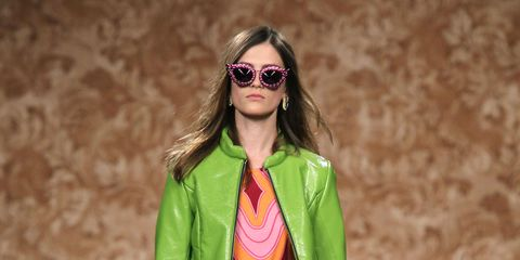 Clothing, Eyewear, Glasses, Vision care, Green, Fashion show, Human body, Sunglasses, Shoulder, Joint,