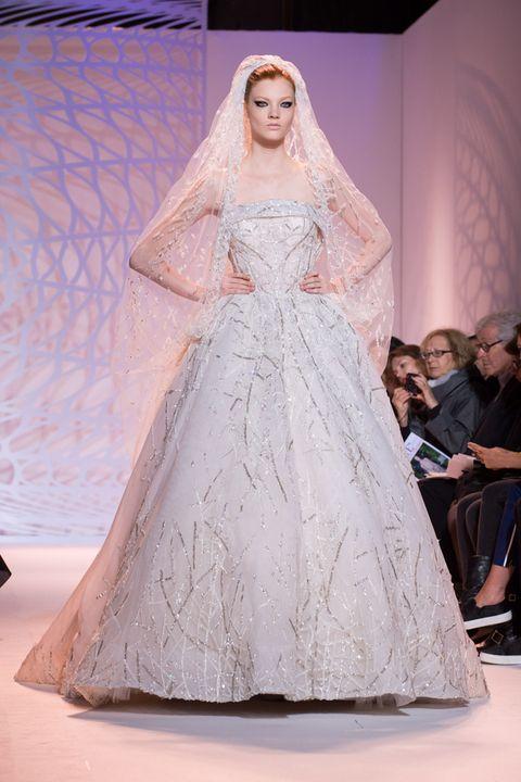 Dress, Bridal clothing, Shoulder, Bridal veil, Veil, Gown, Formal wear, Wedding dress, Bride, Beauty,