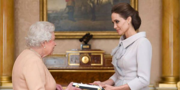 queen elizabeth makes angelina jolie honorary dame