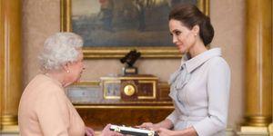 queen elizabeth makes angelina jolie honorary dame