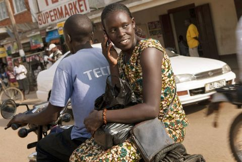 woman on the back of a motorbike in africa