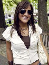 girl with white short sleeve jacket and sunglasses