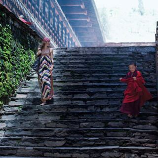 model walking down stairs in bhutan