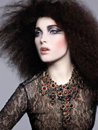 pale model in bright bold eye makeup