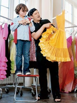 isaac mizrahi and little boy looking at yellow dress