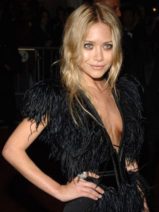 mary kate olsen in black tie with feathers
