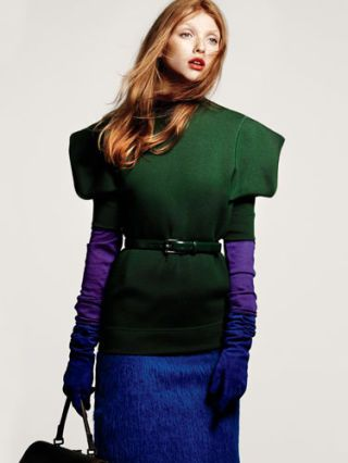 model in purple skirt and gloves and bright green jacket