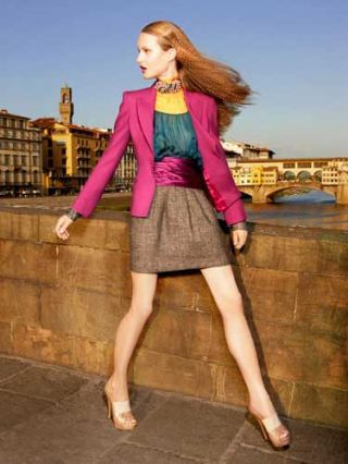 model in pink blazer and brown skirt