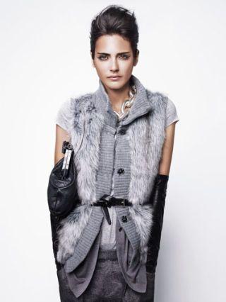 model in gray fur vest and gray skirt
