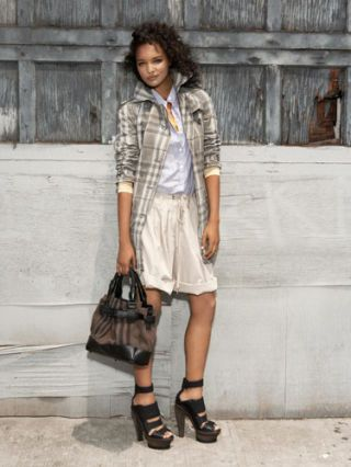 model in burberry shorts and trench
