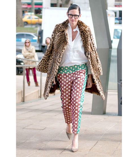 Leopard coat and polka dot trousers.