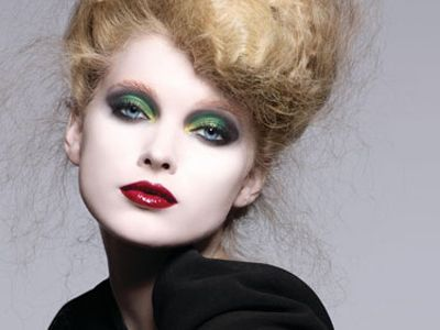 model in bright red lips and green eyeshadow