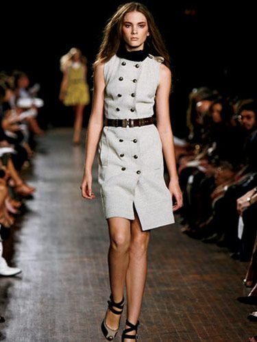 model on runway in a khaki dress