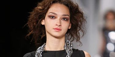 runway model with large necklace