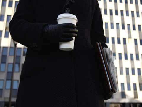 woman with coffee cup going to work