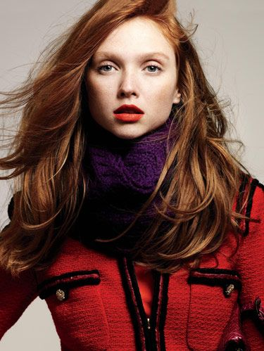 model in bright red jacket and purple scarf