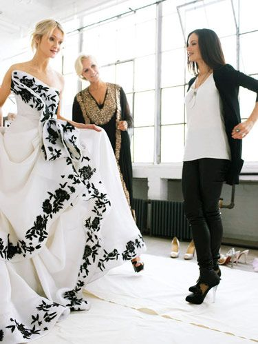 marchesa wedding gown embellished with black flowers