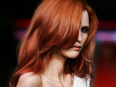 red haired model on catwalk
