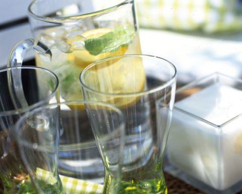 Yellow, Glass, Fluid, Drinkware, Tableware, Liquid, Transparent material, Highball glass, Lemon, Serveware,
