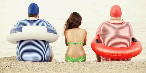 Two overweight men and one woman on beach