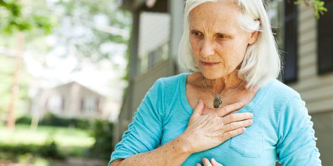 A senior woman experiencing chest pain