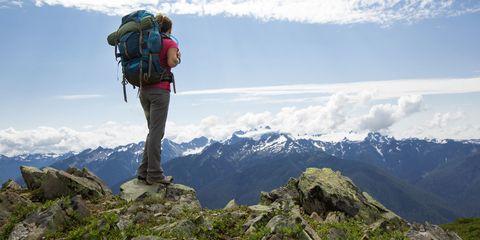 Sky, Mountainous landforms, Cloud, Adventure, Mountaineer, Highland, People in nature, Mountain, Outdoor recreation, Mountain range,