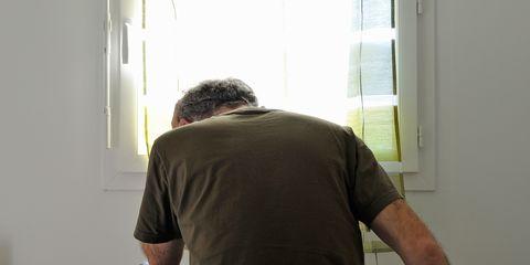 Sleeve, Human body, Shoulder, Elbow, Standing, Joint, Interior design, Back, Window covering, Fixture,