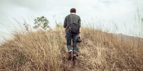 Jeans, People in nature, Boot, Denim, Grassland, Grass family, Jacket, Luggage and bags, Bag, Prairie,