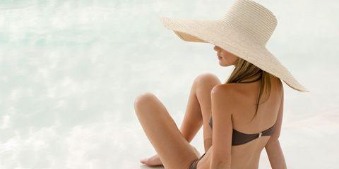 Clothing, Skin, Human leg, Hat, Joint, Summer, Brassiere, People in nature, Sunlight, Headgear,