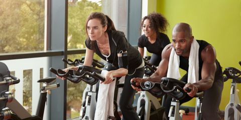 Indoor cycling, Stationary bicycle, Exercise machine, Exercise equipment, Physical fitness, Room, Elbow, Exercise, Gym, Bicycle,