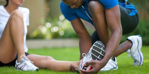 Footwear, Leg, Grass, Shoe, Human leg, Athletic shoe, Elbow, People in nature, Playing sports, Knee,
