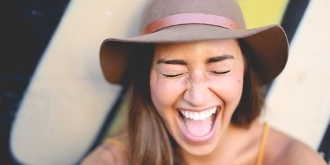Woman laughing with energy