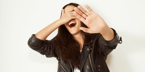Woman embarrassed with hands over her face