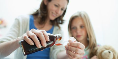 Giving a child medicine